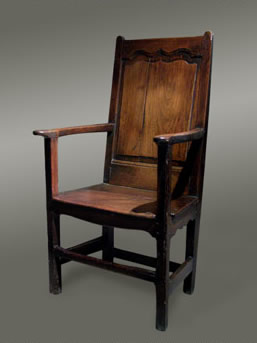 Welsh oak armchair with a fielded ogee-shaped panelled back