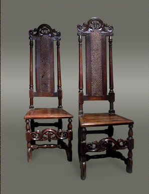 Caned side chairs, the tall backs with turned pillars and carved cresting rail
