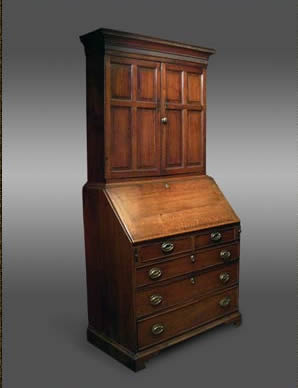 antique oak bureau cabinet with fielded panels to top and with a sycamore interior drawer arrangement