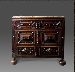 Welsh oak chest of drawers embellished with applied geometric mouldings and incised decoration